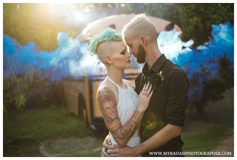 Punk rock wedding couple in front of a bus