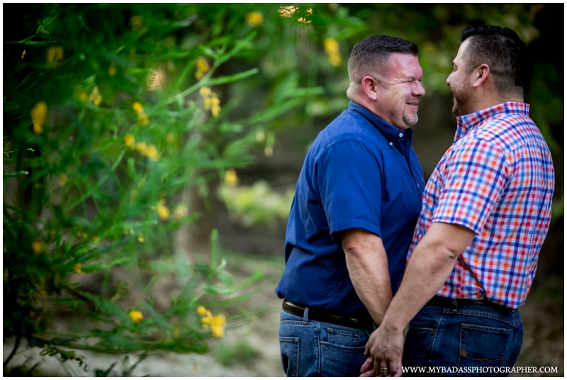 happy gay couple posing for engagement session