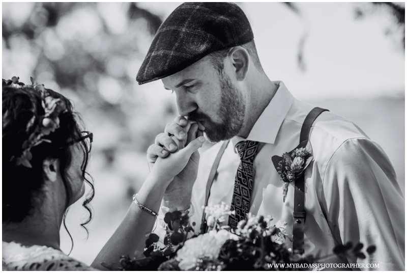 Inspiring Oaks Ranch Wedding - a groom kisses the hand of his bride